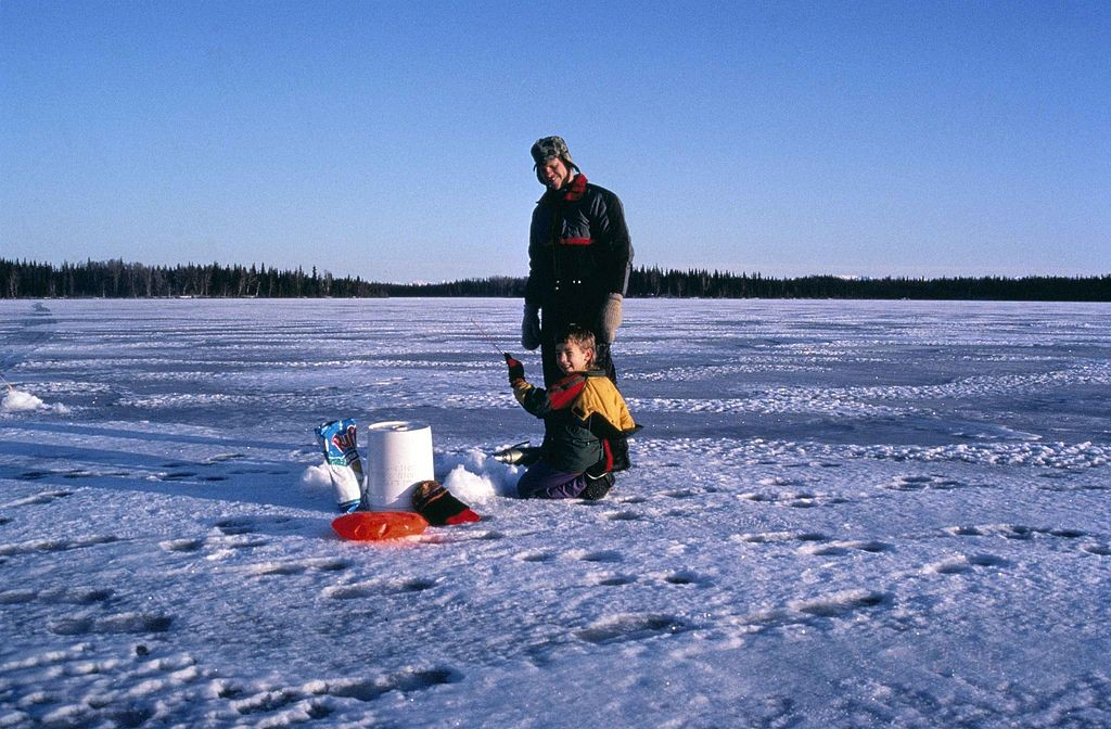 father and son ice fishing in montana
